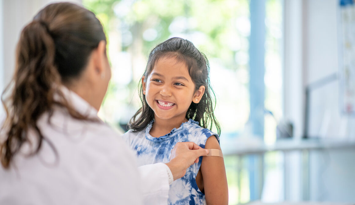 smiling-girl-being-vaccinated
